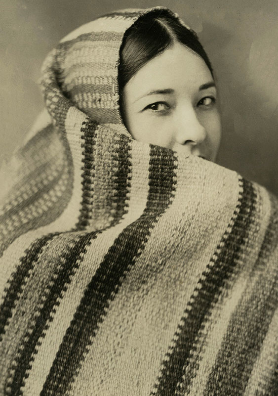 Te Ata wrapped in a blanket