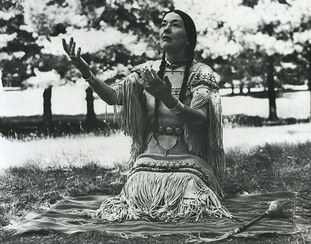 Te Ata seated on a blanket
