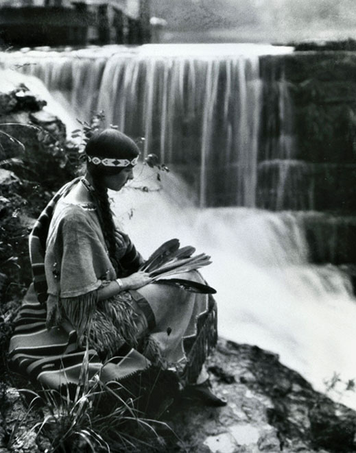 Te Ata sitting by a waterfall