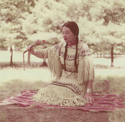 Te Ata holding a ceremonial rattle