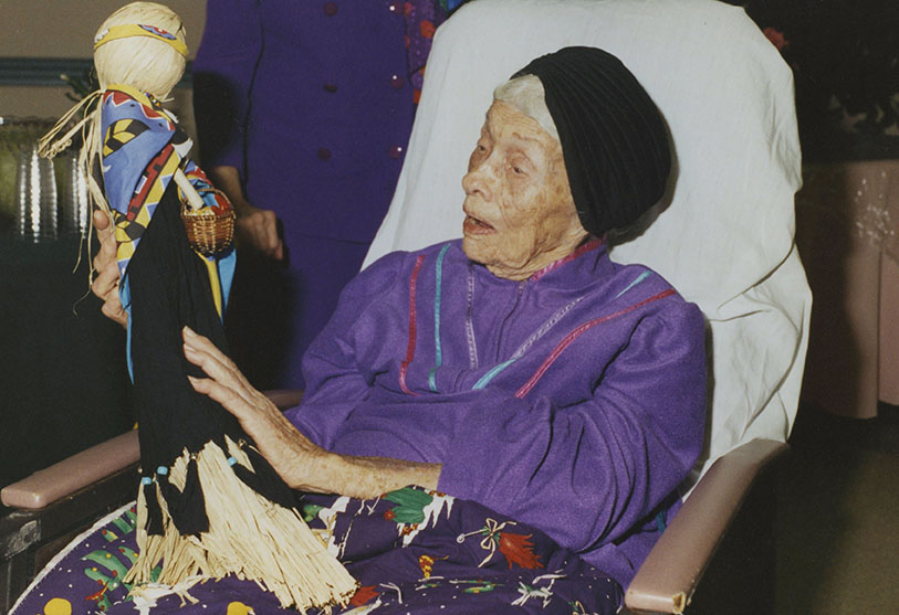 Te Ata is given a doll on her 99th birthday celebration