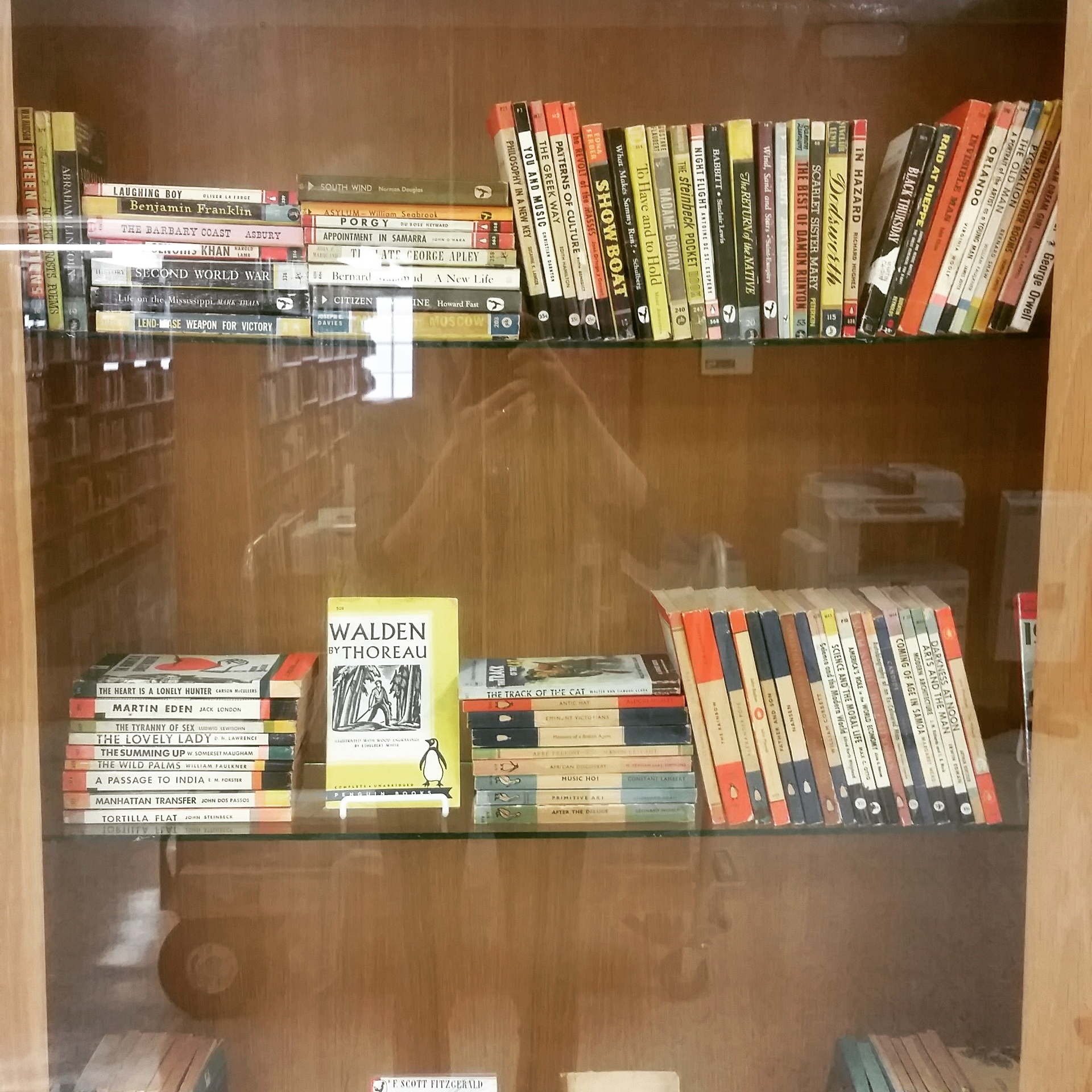 paperback books in display case
